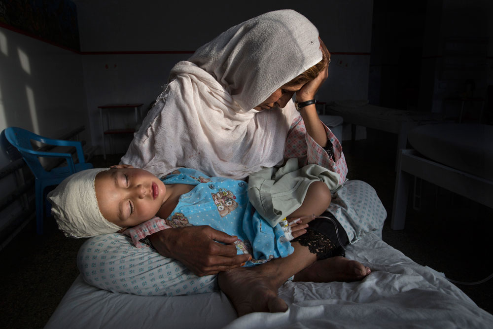 The Silent Victims Of A Forgotten War Najiba holds her nephew Shabir (2), who was injured in a bomb blast that killed his sister, in Kabul, Afghanistan, in March. The bomb exploded in a relatively peaceful part of Kabul while Shabir's mother was walking the children to school. Although the 2001-2014 Afghan War has formally ended, conflict continues in the country, with the Taliban as the chief insurgents and the US and other international forces backing the Afghan military. Fighting moved closer to villages and cities, with an upsurge in suicide bombings and targeted attacks aimed at destabilizing civilian life. According to the UN, child casualties rose 24 percent in 2016, to 2,589 wounded and 923 killed. © Paula Bronstein, Pulitzer Center on Crisis Reporting / Getty Images Reportage