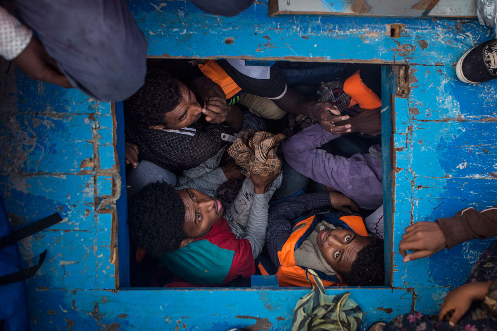 Mediterranean Migration Refugees cram into the hold of a boat containing more than 500 people, off the coast of Libya, in June. Story: Conflict, persecution, political instability and poverty in parts of Africa and the Middle East continued to compel people to make dangerous sea crossings to seek a better life in Europe. Following a migration deal between the EU and Turkey, the numbers of refugees crossing the Aegean to Greece dropped, but arrivals in Italy, across the Mediterranean Sea from North Africa, went up sharply. According to the UNHCR, 181,436 people made that crossing in 2016, an 18 percent increase on 2015. Refugees are frequently crammed into unseaworthy craft, often without lifejackets or sufficient food, water or fuel. Many do not survive the three-day journey to Italy. Rescue vessels operated by NGOs and charities patrol international waters off the north Libyan coast to assist people in distress. © Mathieu Willcocks, MOAS