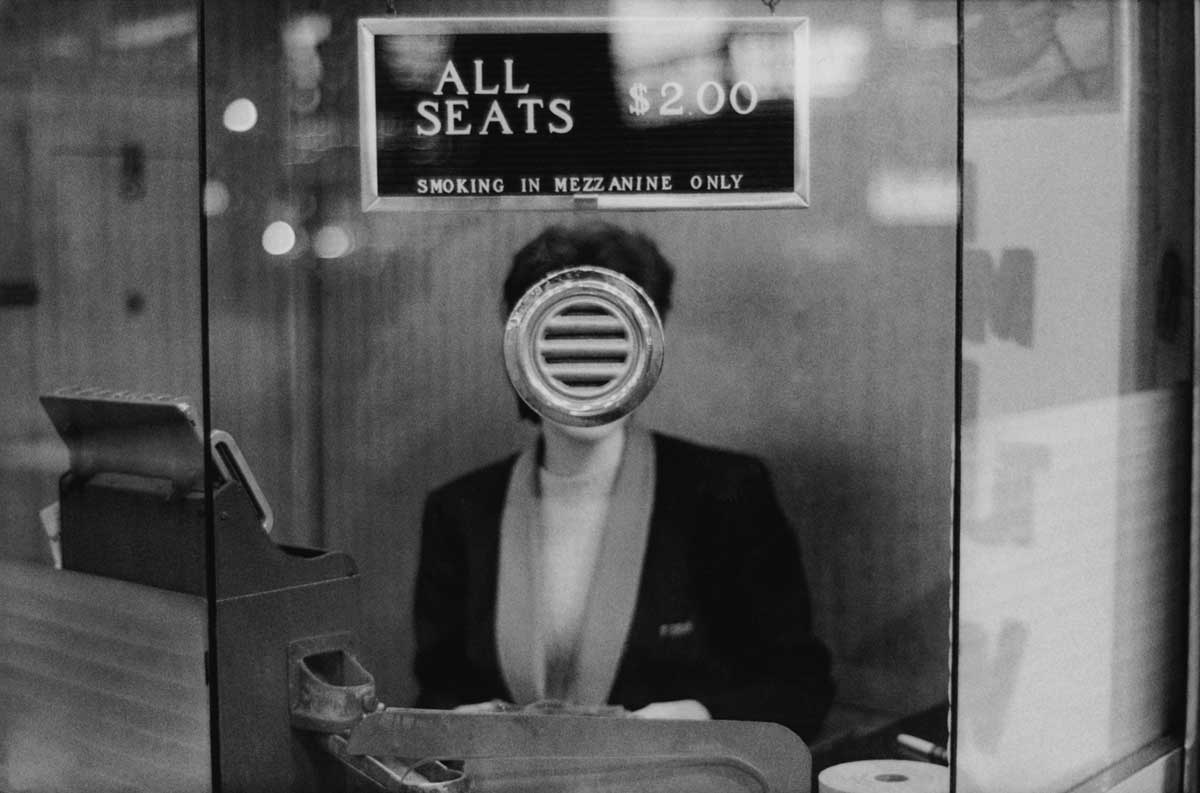 Joel Meyerowitz, Movie Theater Booth, Times Square, New York City, 1963.