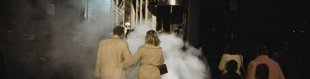 Joel Meyerowitz Camel Coat Couple in Street Steam, New York City, 1975.